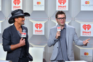 Bones, who grew up in Arkansas listening to Tim McGraw, now finds himself interviewing McGraw on red carpets for iHeart Radio and on his show. McGraw even gave Bones one of his famous black cowboy hats. PHOTO BY BRYAN STEFFY OF GETTY IMAGES FOR CLEAR CHANNEL