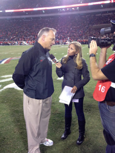Dawn Davenport working as a sideline reporter for Saturday night prime time broadcast on ESPNU interviewing Georgia head football coach Mark Richt. PHOTO COURTESY DAWN DAVENPORT