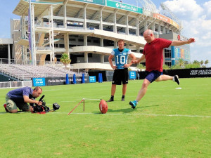 Paul Kuharsky, while covering the AFC South for ESPN.com found himself getting a kicking lesson from Jacksonville Jaguars kicker Josh Scobee in 2013. PHOTO COURTESY OF PAUL KUHARSKY