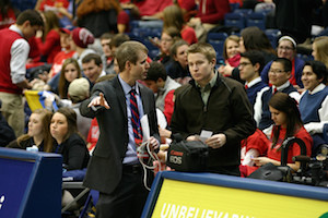 Prior to tip-off of the Belmont vs. Murray State game, Sage shows visiting media member Adam Wells of WPSD in Paducah, Ky. where he can film from and prepares him for the game. PHOTO BY MATTHEW MAXEY