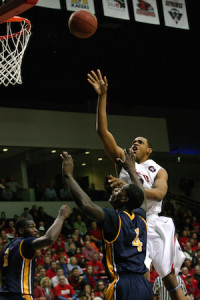 Belmont's Blake Jenkins lets go of a floater in the lane over a pair of Murray State defenders helping the Bruins pick up a 99-96 win over the Racers en route to the OVC Regular Season Title. PHOTO BY MATTHEW MAXEY