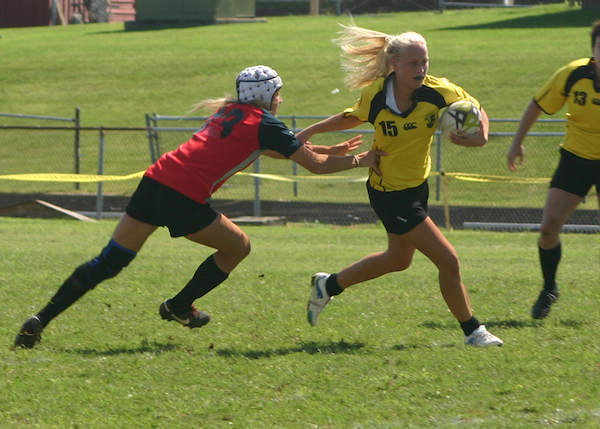 A Nashville Stone Lion gives a stiff arm as she breaks through a tackle attempt.