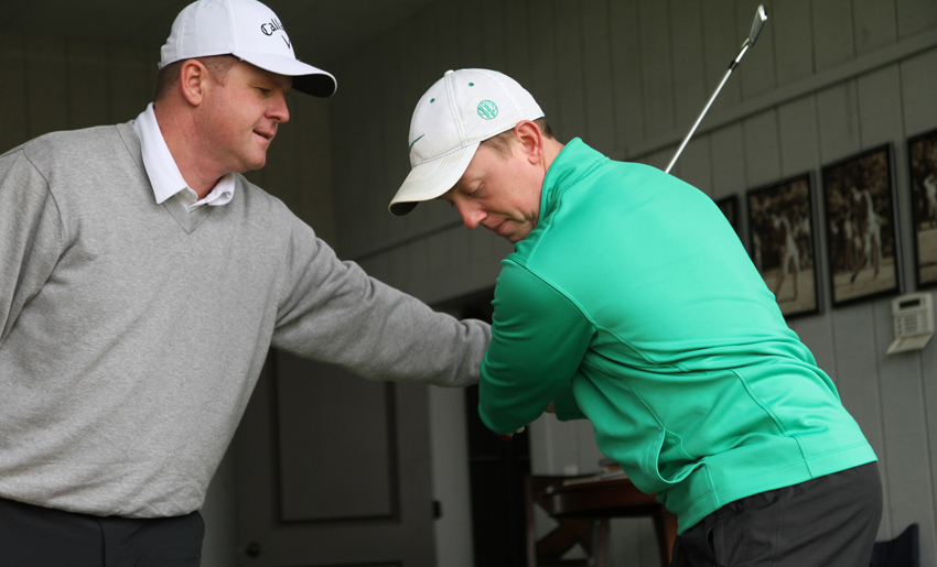 Herring guides Westhaven's Director of Player Development Matt Walter through the feel of a proper golf swing. PHOTO BY MATTHEW MAXEY