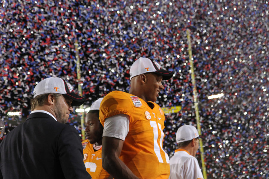 Josh Dobbs under a sea of confetti.
