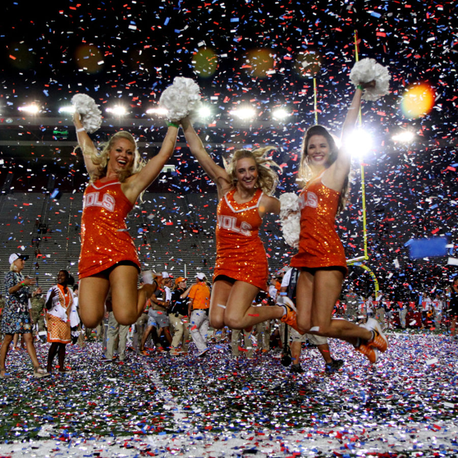 The Tennessee Dance Team doing what you'd naturally do when it's raining confetti.
